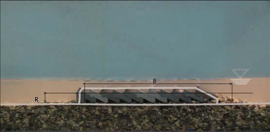 The beach started with the slope of 1/10 for 2m distance and changed the slope with 1/30 until the flat section. The model of the submerged breakwater was installed at the toe of the flat section.