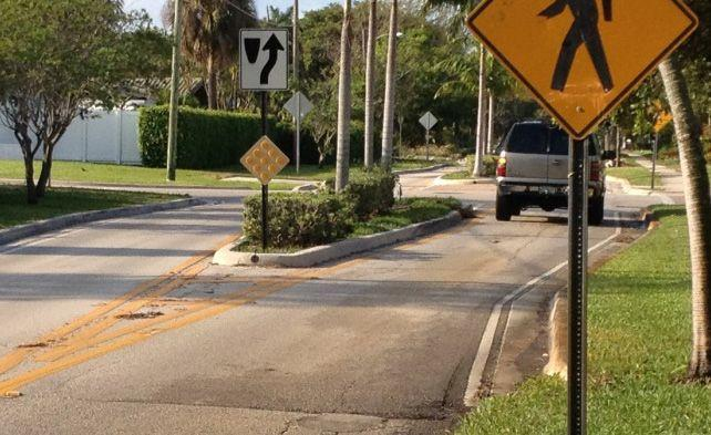 Credit: Kittelson & Associates, Inc. MEDIANS AND MINI MEDIAN ISLANDS Islands constructed between travel lanes can help to narrow the lanes and thus slow down traffic.
