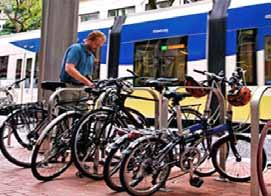 Bicycle parking can be as simple as a staple rack (see photo above) or an inverted U rack adjacent to a transit shelter.