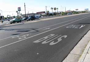 In some cases the vehicle travel lane width may be minimized in order to provide greater accommodation for bicycle or transit usage or to simply reduce vehicle travel speeds for safer pedestrian