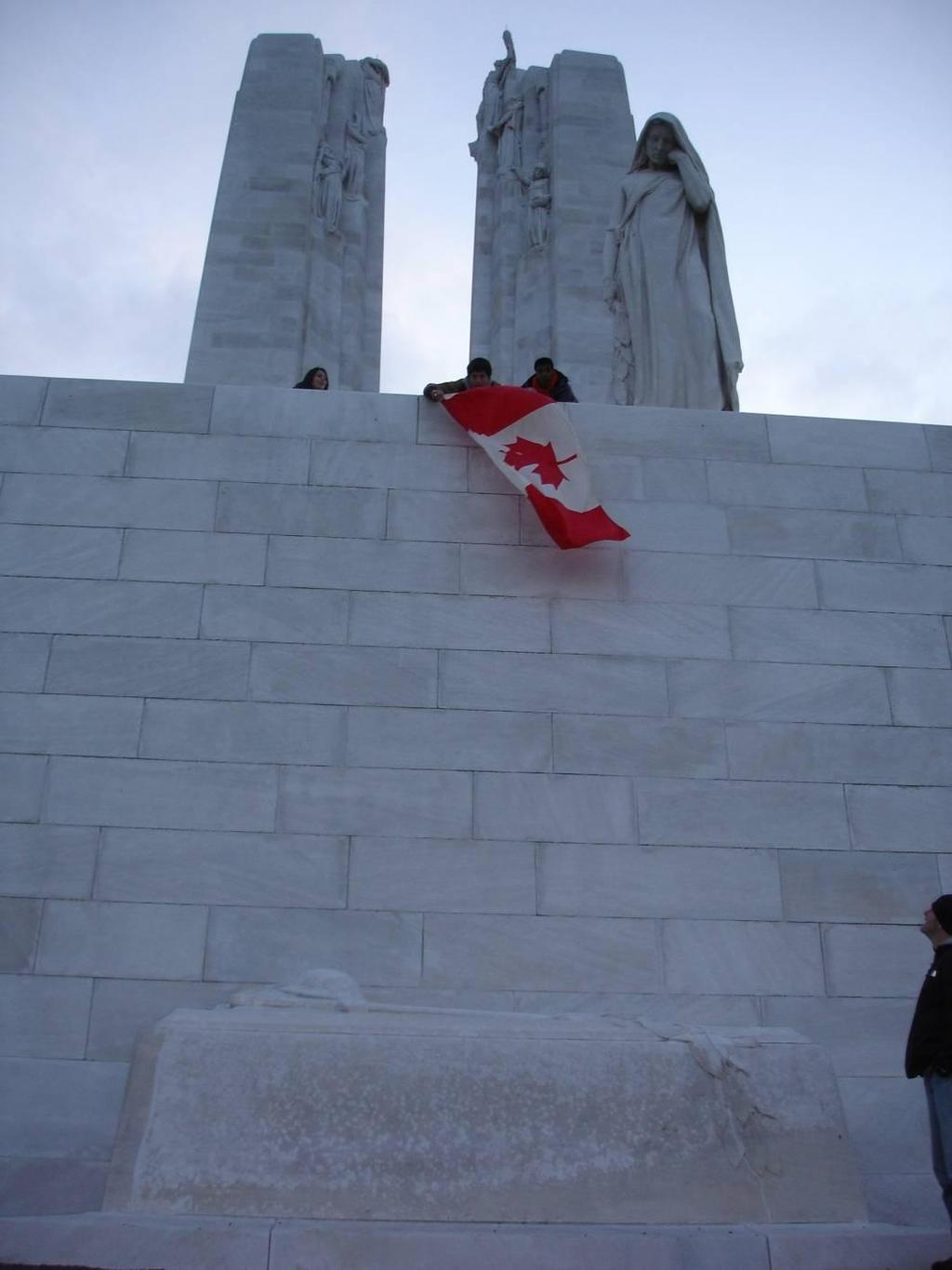 The Mourning Woman looking down on the casket represents Canada