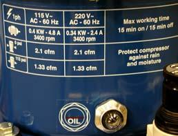 Verify that the oil level is at MID level mark.