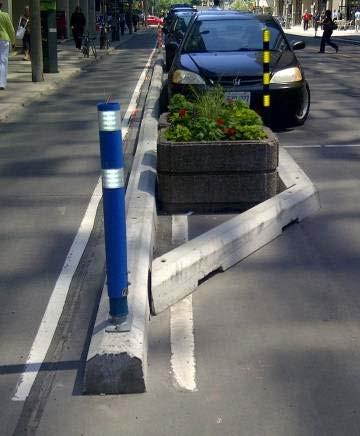 Gerrard Street) Concrete median islands with trees (Montreal PQ)