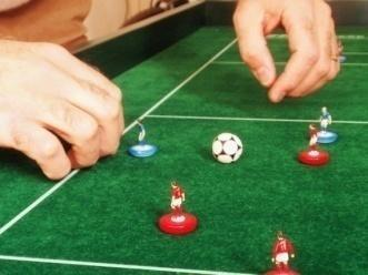 However, neither player may: a. Put his other hand on or above the playing area while flicking, even if the flicking hand is outside the playing area.