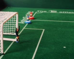 with last defending playing figure Playing figure behind the ball Playing figure on the goal-line with two defending playing figures