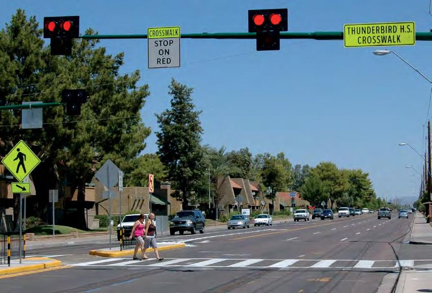 A pedestrian hybrid beacon (PHB) is a traffic control device similar to a European pedestrian signal (PELICAN) that was imported to the US and adapted by engineers in Arizona to increase motorists