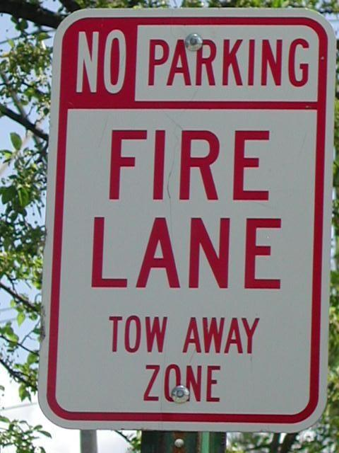 Parking next to the curb in the Fire Zone with signs posted is illegal and carries a