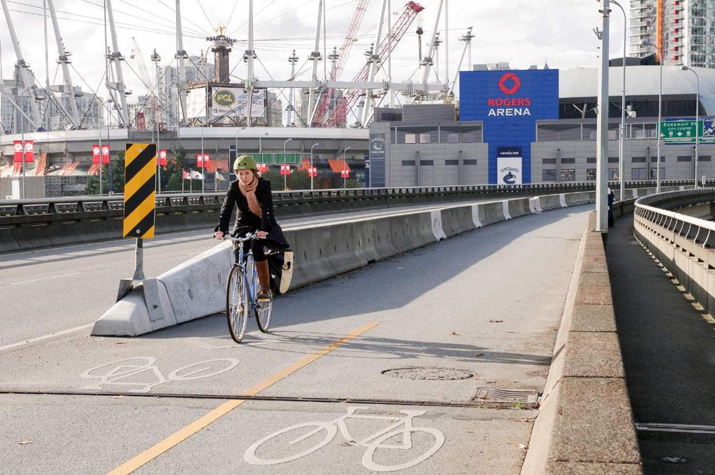 in the two southbound general traffic lanes Reduce bicycle volumes on the east side shared-path by providing an