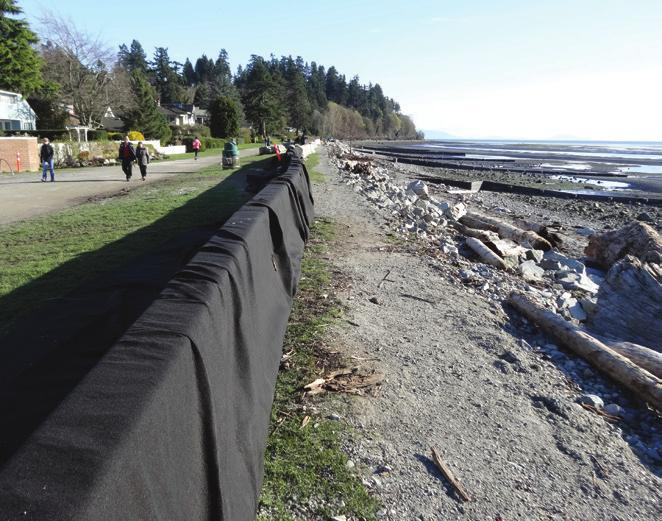 7 Temporary concrete barriers put up after March 10th, 2016 storm damage. Storm surge in January 2010 during a king tide event, which resulted in the tides overtopping the dyke.
