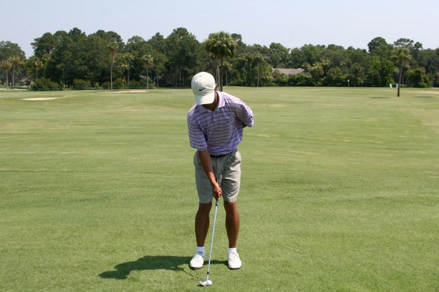 SHORT GAME ONE ARM SWING Practice some pitch shots with your left arm behind your back.