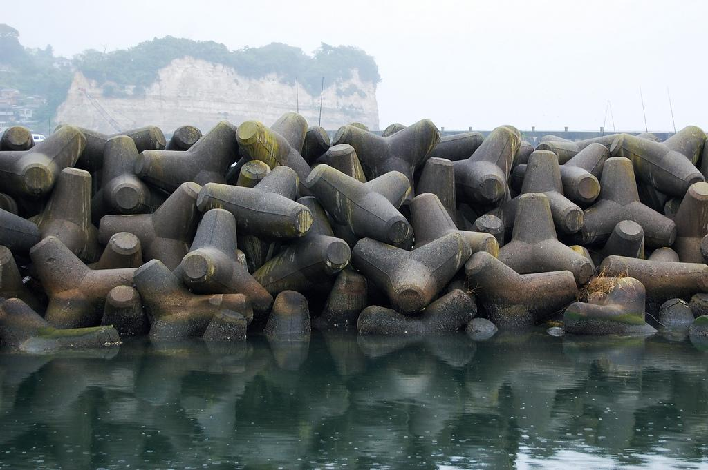 Tetrapods Four legged concrete structure used as armour unit on breakwaters.