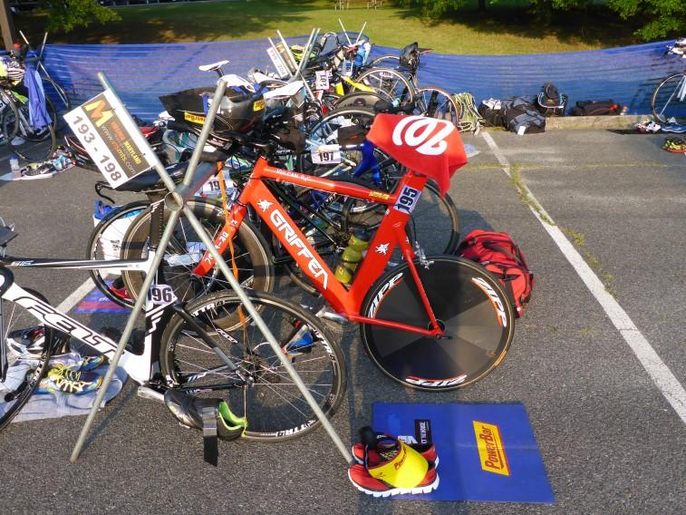 Bike racks are numbered and triathletes must put their bicycles and gear on their designated rack. E ach rack holds 6 bikes, with positions on racks being based on a first come, first serve basis.