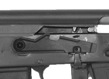Gas tube 10. Barrel 11. Front sight 12. Compensator 13. Cleaning rod attachment 14. Lower handguard 15. Magazine 16. Magazine release lever 17. Trigger 18.