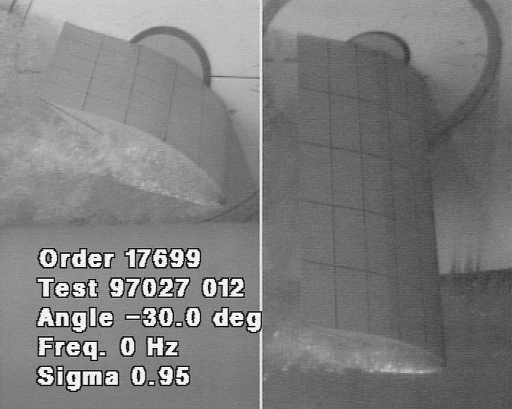 occurs between 5 and degrees angle of attack. Photographs 3 and 4 shows that almost the complete fin is covered by cavitation above α = degrees.