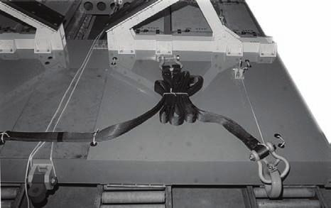 Chapter 4 6 7 8 9 6 0 6. 7. 8. 9. Pass an 8-inch length of /-inch tubular nylon webbing through each pair of deck holes to the right of the extraction bracket.