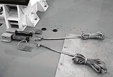 Insert the T-pin through the push rod holes when the holes are aligned with the pin bracket. Connect the drawbar cable to the bolt end of the halyard shackle (Not shown).. 3. 4. 5. 6. 7. 8.