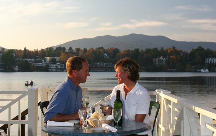 Boat House Summer Deck Dining A perfect Adirondack evening begins at the Lake Placid Club Boat House on the pristine shores of Mirror Lake.
