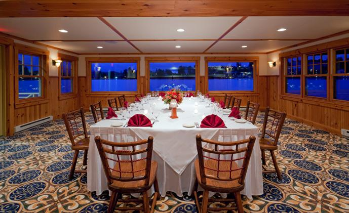 With its large covered deck extending over the lake, the Boat House affords a truly memorable vantage point with magnificent sunsets, making it a favorite dining