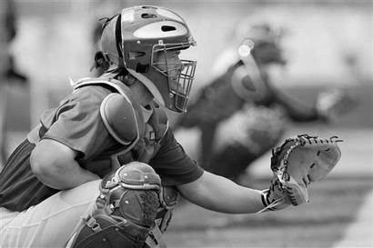 STANCE The stance of a catcher will determine the ability to balance within all the movements required to receive, block, throw, and field his position.