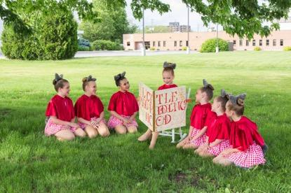 Mini Competitive Company General Information Age Range: 7 to 9 years (approximately) Audition Required: Yes Routines and Choreography Number of dances: 4 (approx.) Number of costumes: 4 (approx.