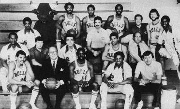 1981-1982 CHICAGO BULLS Left to right: (first row): Reggie Theus, Chairman of Executive Committee Arthur M. Wirtz, Ricky Sobers, Ronnie Lester, General Manager Rod Thorn.