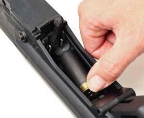 Chambering from Magazine Figure C-2: Loading a Shell into the Magazine Tube 1. Ensure the magazine selector is oriented to feed from the desired magazine tube. 2.