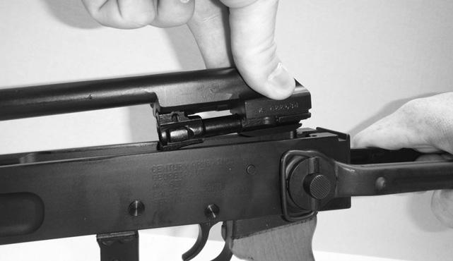 6. Remove the bolt carrier and bolt from the rifle by holding the receiver with one hand and the cocking handle with your other hand. Pull the bolt carrier and bolt to the rear as far as possible.