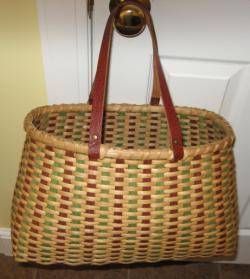 It is woven with all natural reed in different sizes and accented with a ring of seashell. The basket has a unique rim.
