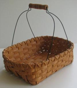 Approx 12 high Chocolate and Cinnamon Charlie Coleman $45 This basket is made on a double slotted base.