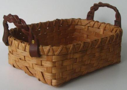 It is make of dark brown and light brown Classy Buns Wanda Harris $30 This little basket is approximately 7 X 9 X 3