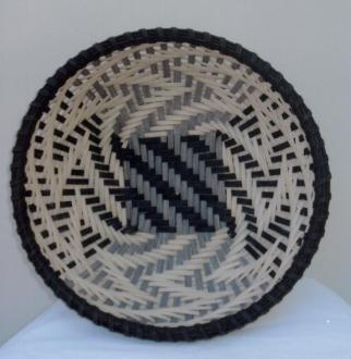 Woven on a class mold in a chase weave with natural and black cane. Staves will be pre-inserted prior to the class.