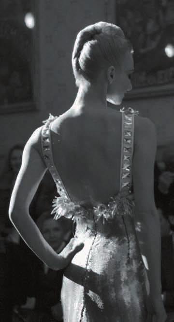 The ballerina first appeared on the runway in the guise of the black swan, then in a golden hued evening dress, and finally in a white lace outfit.