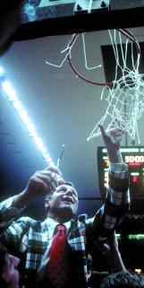 Norm Sloan cut down the net after leading North