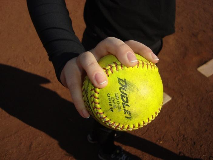 Pitching motion in 5 steps: 1. Both feet touching rubber, ball in hand in glove with proper grip 2.