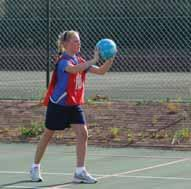 ball and thumbs towards the back, with elbows bent and tucked in With a quick thrust, pass the ball