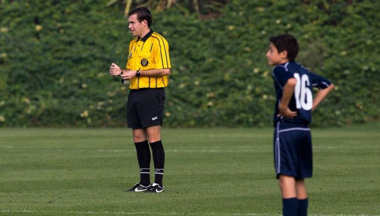 Too Many Players If the referee realizes that there are too many players during a stoppage of play, they should caution
