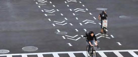 Intersection treatments can improve both queuing and merging maneuvers for bicyclists, and are often coordinated with timed or specialized signals.