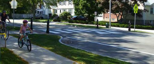 Accessibility: All corner features, such as curb ramps, landings, call buttons, signs, symbols, markings, and textures, should meet accessibility standards and