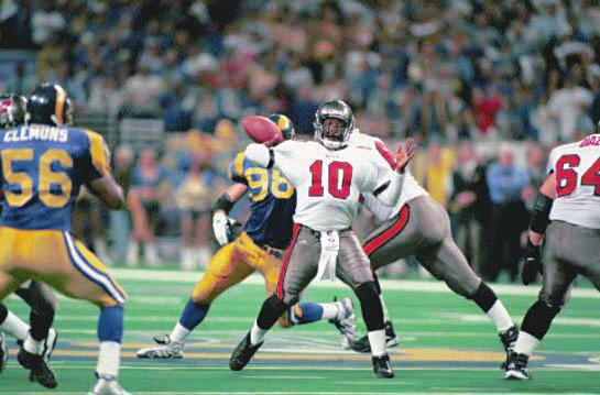 DE Steve White intercepted NFL MVP Kurt Warner on the first play of the game, setting up the Tampa Bay offense at the St. Louis 20. Martin Gramatica booted a 25-yard FG, giving the Bucs a 3-0 lead.