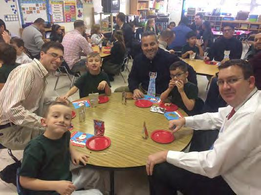 Christmas in the Younger Grades By Ainsley Rush, Allison DiLollo & Ryan Horn In December, Kindergarten celebrated Donuts with Dads.