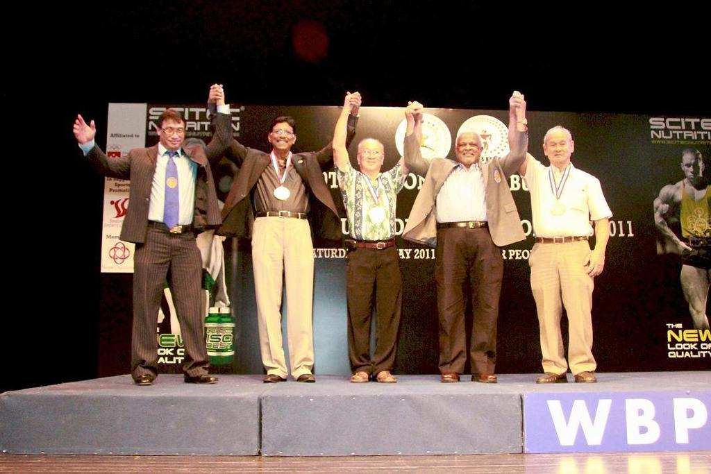 WBPF Gold Medal Awarded to Mr.M.Letchmenon, Mr. Peter Teo and Mr. Pang Nai Seng by Mr. Paul Chua Left to Right Prof. Dr. Rano Izhar (Organising Chaiman), Mr. M. Letchmenon (Ex-President SBBF), Mr.