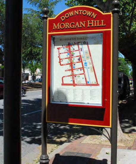 PEDESTRIAN SIGNAGE Providing direction and distance information for major destinations can enhance residents walking experience and help visitors find their way around the City.