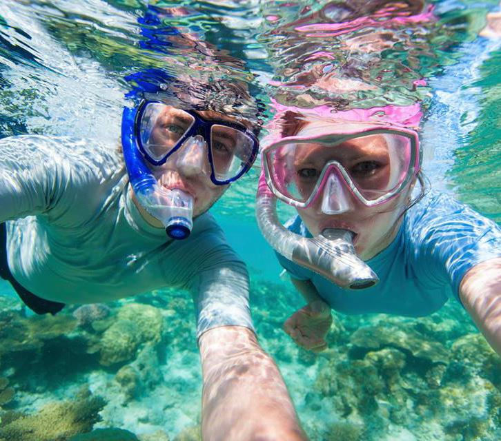 Snorkeling offers views of all kinds of rays, turtles and rivers of wrasse swimming along stunning coral structures.