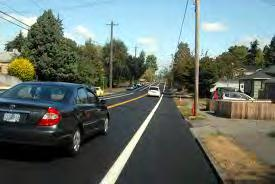 Narrow Travel Lanes are created by using pavement markings, raised pavement markers or vertical panels, as shown in Figure 2.