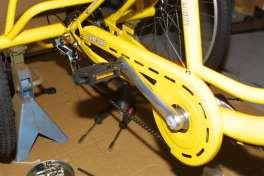 Once the chain in place it is then necessary to raise the rear of the Trike-Bike so the pedals can be turned and any adjustments