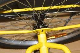 Fit the rear brake cable as shown in the photograph, again it is necessary to partially squeeze the brake arm and then tightened the