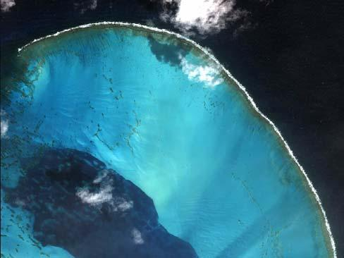 Atoll Atolls are rings of reef, often encircling an island having a shallow, sandy, sheltered lagoon in the middle Atolls grow on top of the submarine mountains which are