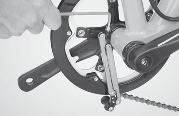 To adjust the chain tensioner, first loosen the nut at the lower derailleur jockey wheel. Then loosen the bolt. Adjust the chain tensioner.