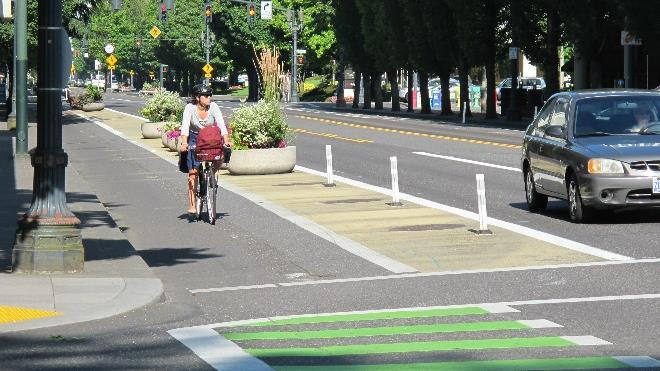Pair of one-way protected bike lanes on a