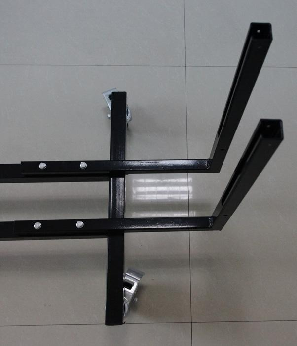 portion of the table into the angled track bar. Make sure that the table surface is facing inward.